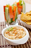 Hummus with vegetables, olive oil and pita chips Royalty Free Stock Photography