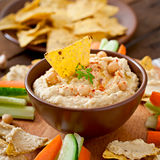 Hummus with vegetables, olive oil and pita chips Royalty Free Stock Photo
