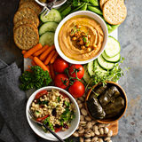 Hummus and vegetables platter with grain salad Stock Photo