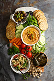 Hummus and vegetables platter with grain salad Royalty Free Stock Photo