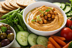 Hummus and vegetables platter with grain salad Royalty Free Stock Image