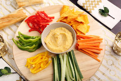 Hummus with vegetables on a wooden swivel table Stock Photography