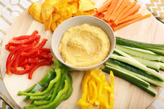 Hummus with vegetables on a wooden swivel table Stock Image