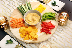 Hummus with vegetables on a wooden swivel table Stock Photo