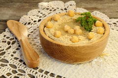 Hummus in a wooden bowl Royalty Free Stock Photo