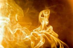 Humo de oro abstracto del calor Fotos de archivo