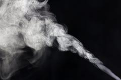 Humo en un fondo negro Foto de archivo