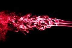 Humo rojo aislado en negro Fotografía de archivo libre de regalías
