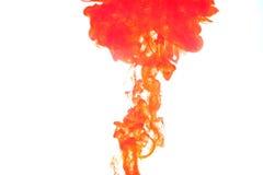 Humo rojo causado. Imagenes de archivo