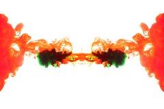 Humo rojo y verde. Fotografía de archivo libre de regalías