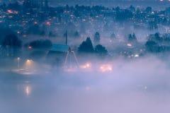 humo a través de la ciudad Imagenes de archivo