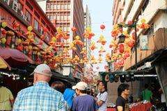 Humor chino del Año Nuevo en la calle petating Foto de archivo libre de regalías