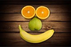 Humor. Banana fruit food fun orange smiley face Stock Photo