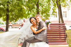 Humor at the wedding.  groom sitting on bride Stock Image
