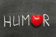 Humor. Word handwritten on blackboard with heart symbol instead of O stock photography