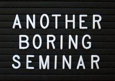 Humoristisch neem Seminaries over die een afval van tijd zijn stock fotografie