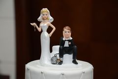 Humorous Ball and Chain Wedding Cake Topper Close-up.  Royalty Free Stock Images