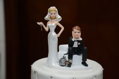 Humorous Ball and Chain Wedding Cake Topper Close-up.  Stock Photos