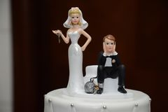 Humorous Ball and Chain Wedding Cake Topper Close-up.  Royalty Free Stock Photos