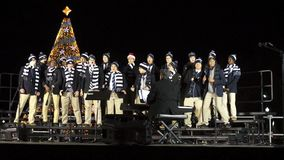 Humorous Christmas Carol at the Ellipse in Washington DC. Video of a childrens choir singing a humorous christmas carol at the ellipse in washington dc at night stock video