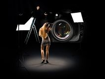 Humorous collage of photographer and model Royalty Free Stock Photos