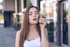 Humorous comic emotion facial expressing people person teenager concept. Close up photo portrait of funky satisfied delightful att. Ractive lady holding glass stock images
