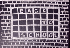 Humorous concept of hate school as prison with handwriting text. Back to school is written in chalkboard, close up Stock Images