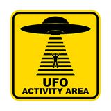 Humorous danger road signs for UFO, aliens abduction theme, vector illustration. Yellow road sign with text Ufo Activity Area. Humorous danger road signs for vector illustration
