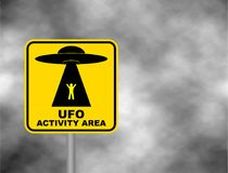 Humorous danger road signs for UFO, aliens abduction theme, vector illustration. Yellow road sign with text Ufo Activity Area. Background of dark grey sky with Royalty Free Illustration