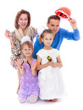 Humorous family portrait mom dad and two adorable Royalty Free Stock Photos