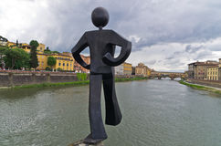 Humorous figure statue of a jumper in front on Ponte Vecchio bridge in Florence Royalty Free Stock Photography