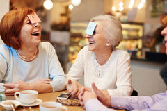 Humorous game. Senior buddies playing humorous game at leisure Stock Images
