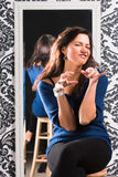 Humorous gesturing. The young woman playfully gesticulates Stock Images