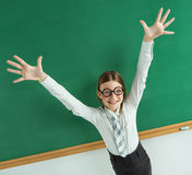 Humorous high angle view of Thrilled pupil raise her palms up Stock Photos