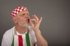 Humorous image of mature Italian chef. Taken with copy space stock photography