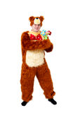 Humorous man in bear suit with toy flowers isolated on white Stock Photos