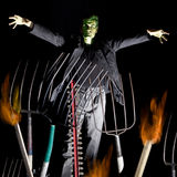 Humorous monster. Humorous frankenstein setup with pitchforks and flames Royalty Free Stock Image