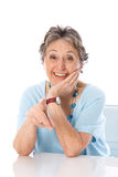 Humorous older lady pointing - elder woman isolated on white bac Royalty Free Stock Photography