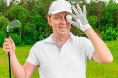 Humorous photo golfer with a ball and golf club Royalty Free Stock Images