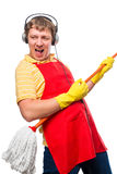 Humorous photo male housewife with a mop Stock Photos