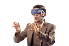 A humorous photo of modern technologies. Young guy with a phone attached to the head using a tape. Virtual reality gadget. Cut out on white Stock Images