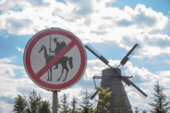 Humorous road sign and a mill Stock Photo