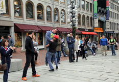 Humorous scene with street performer carrying sightseer into show,Faneuil Hall,Boston,December,2014 Royalty Free Stock Photography