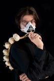 Humorous shot of vampire in respirator. Holding garlic, isolated on black background Stock Photo