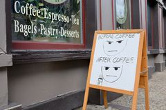 Humorous Coffee Shop Cafe Sign. Humorous sidewalk sign for coffee shop cafe offering coffee, espresso, tea, bagels, pastries and desserts Royalty Free Stock Photos