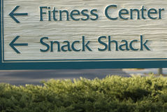 Humorous sign. Contradictory sign of fitness and snacking stock photos