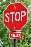 Humorous Stop Sign. A humorous stop sign, warning drivers to REALLY stop Stock Images