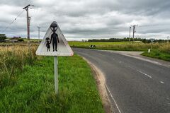 Free Humorous Weathered Danger Road Sign Warning Of Possible UFO In Scotland Stock Photos - 174409413