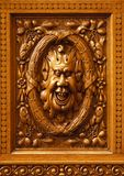 Humorous wooden carved face. Royalty Free Stock Photos