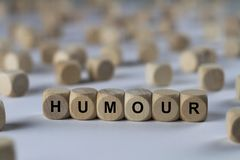Humour - cube with letters, sign with wooden cubes Stock Images